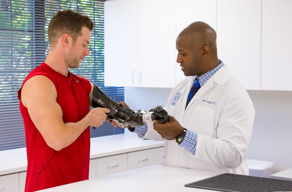 Upper Limb Prosthetist Julian Wells working with patient Max Okun