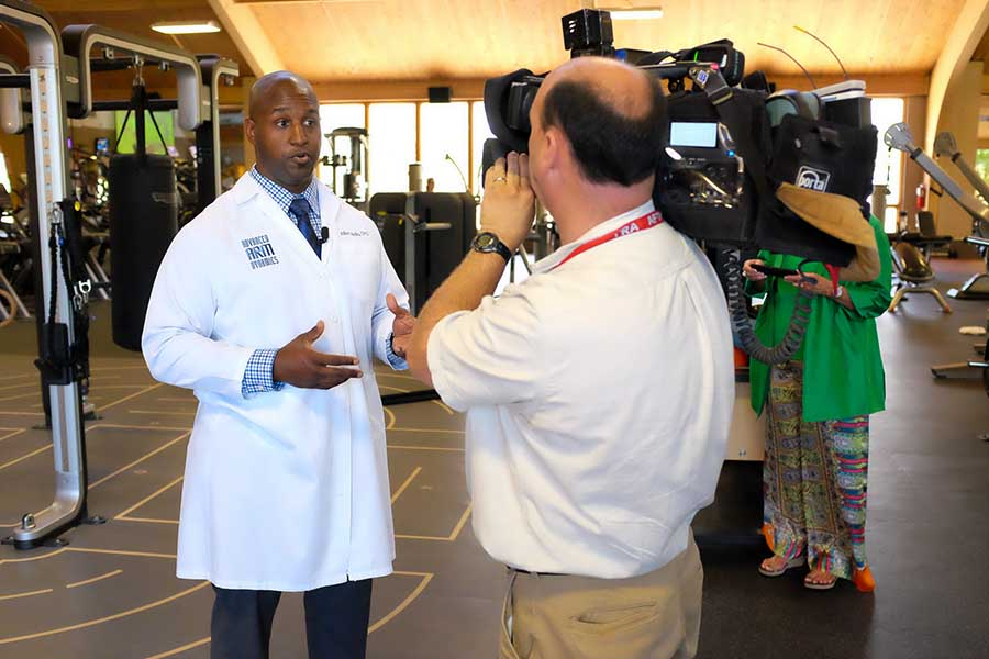 Arm Dynamics prosthetist being interviewed by a news crew