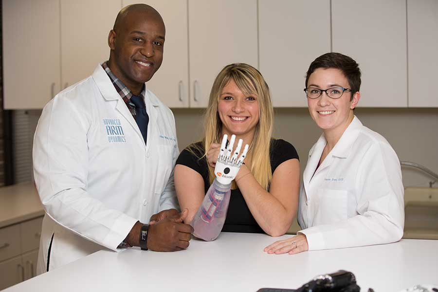 Arm Dynamics clinicians with a patient