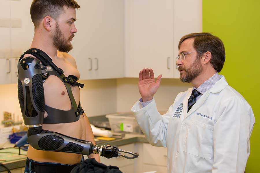 Arm Dynamics prosthetist working with a patient