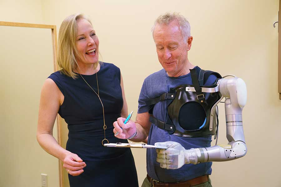 Arm Dynamics occupational therapist working with a patient to demo new technology