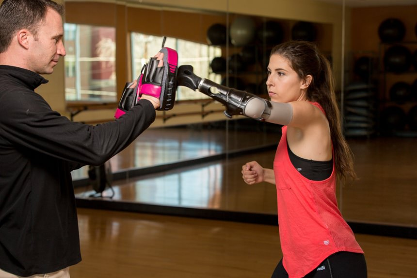 Angel Giuffria training with clinician Rob Dodson in gym
