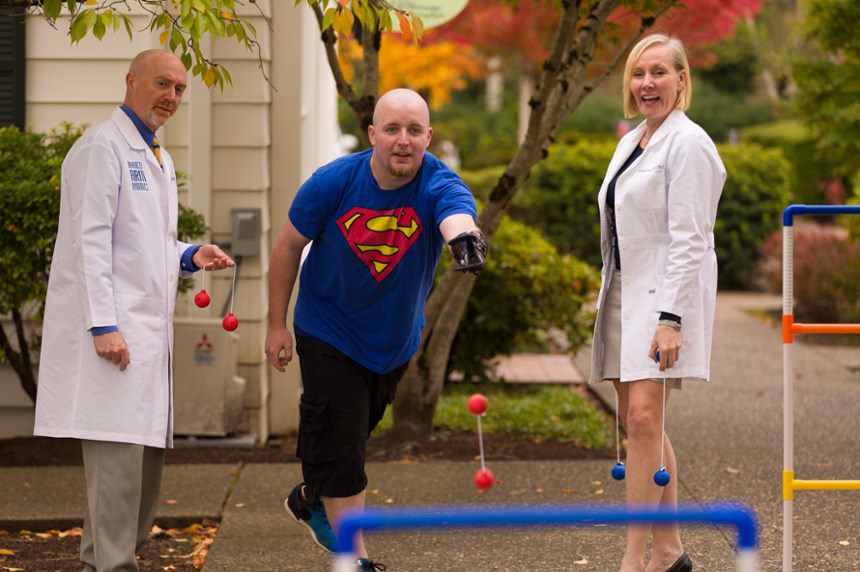 Patient playing fun games outdoors with therapist Kerstin Baun and Dan Conyers, National Clinical Director