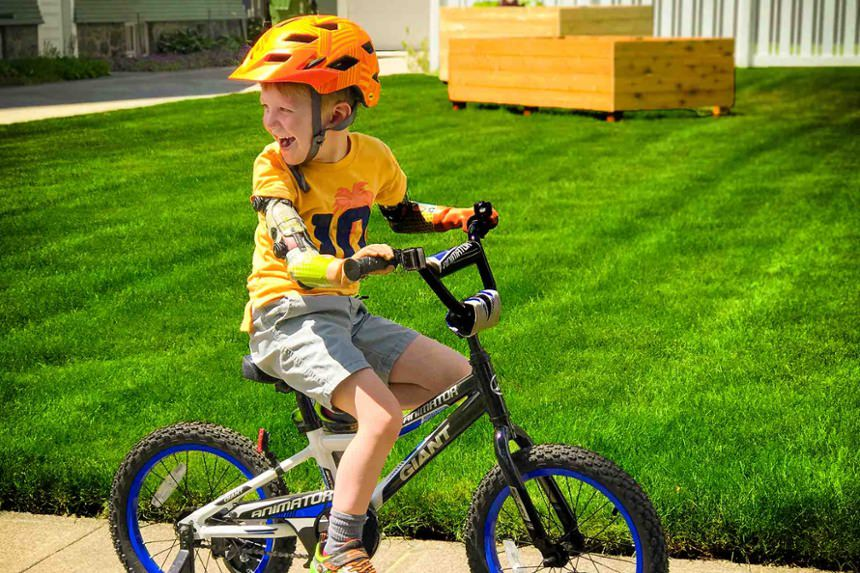 Arm Dynamics pediatric patient riding a bike