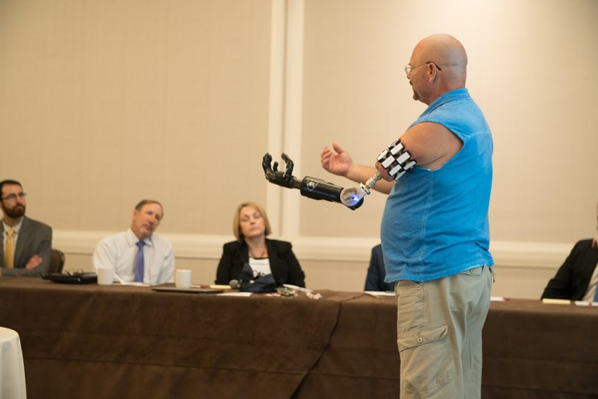 Osseointegration patient presenting at Arm Dynamics' upper limb prosthetic symposium