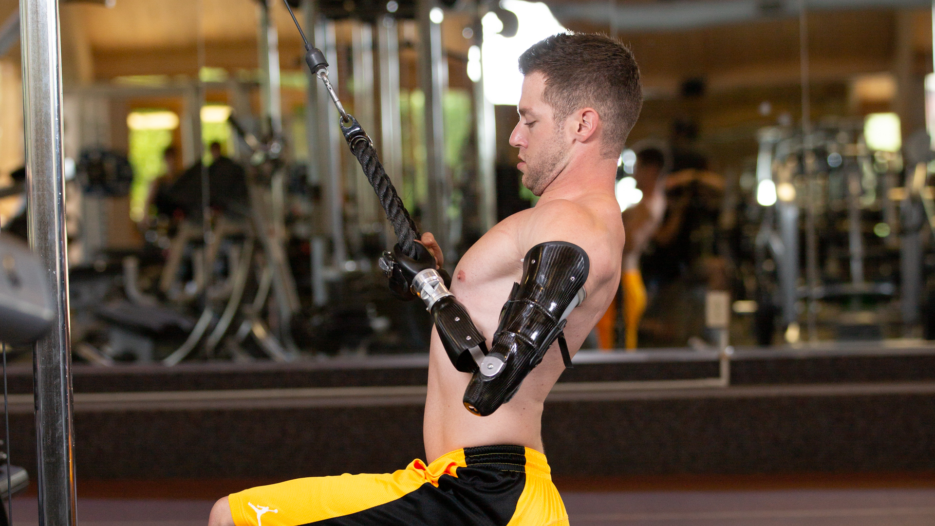 Max Okun works out with custom designed workout prosthesis