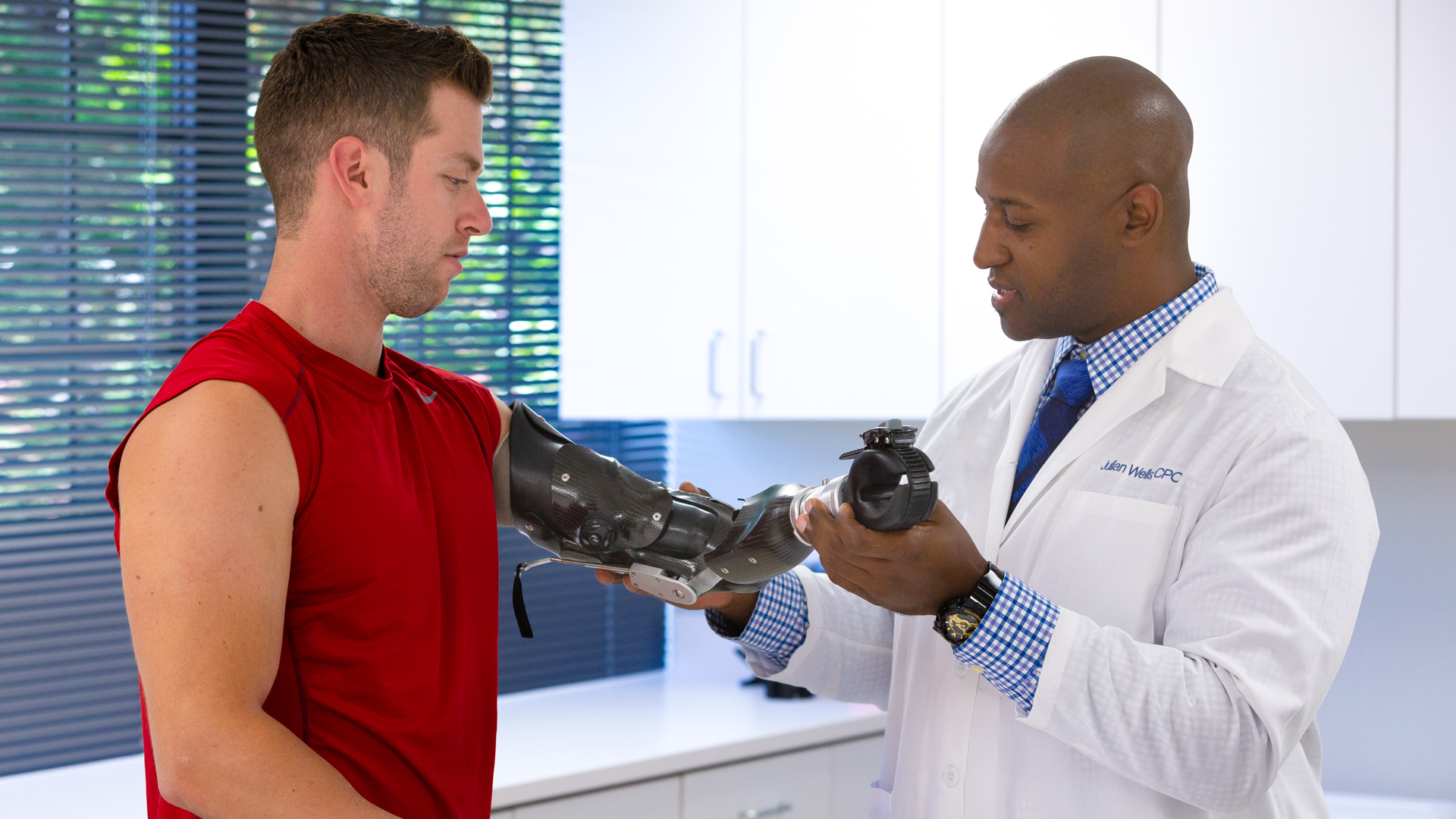 Prosthetist Julian Wells working with Max Okun on activity-specific workout prosthesis