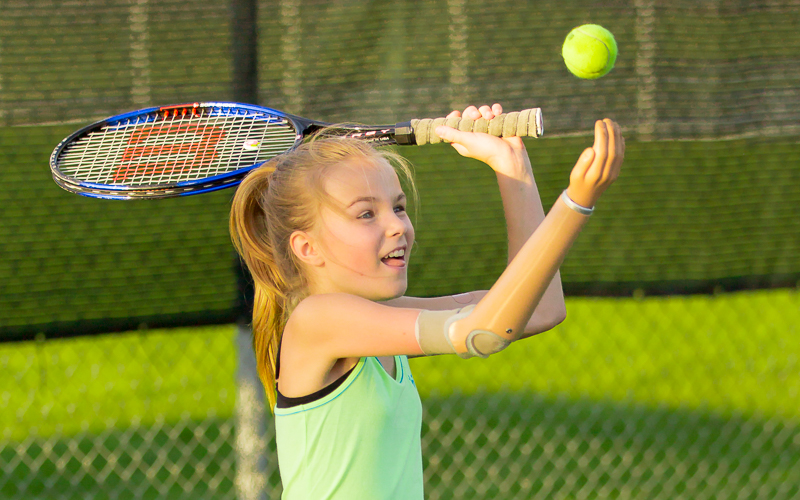 Amber Peterson playing tennis in Minnesota