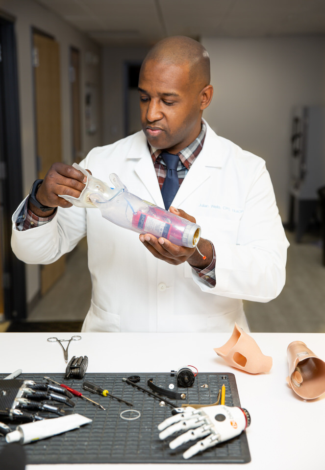 Prosthetist Julian Wells working in the lab