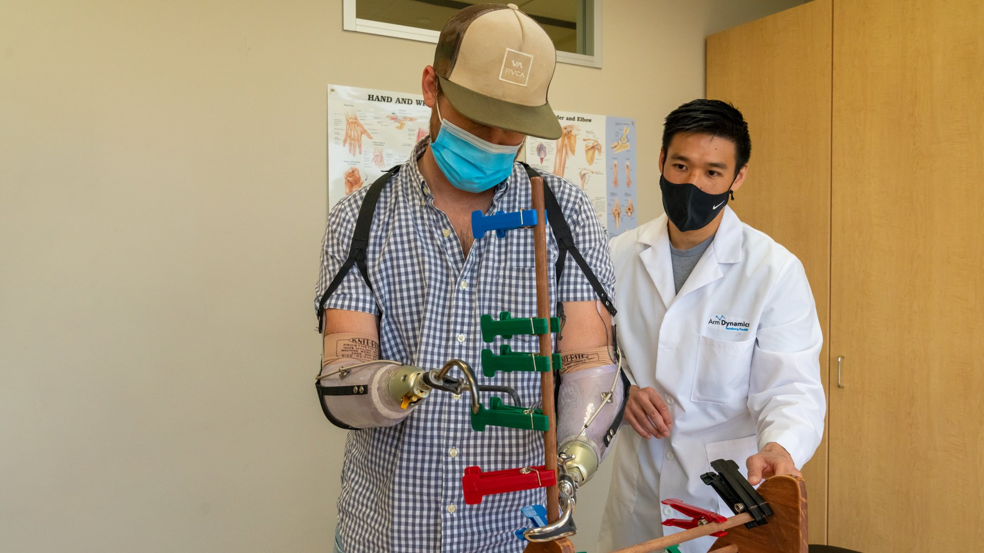 Arm Dynamics clinical therapy specialist working with a patient