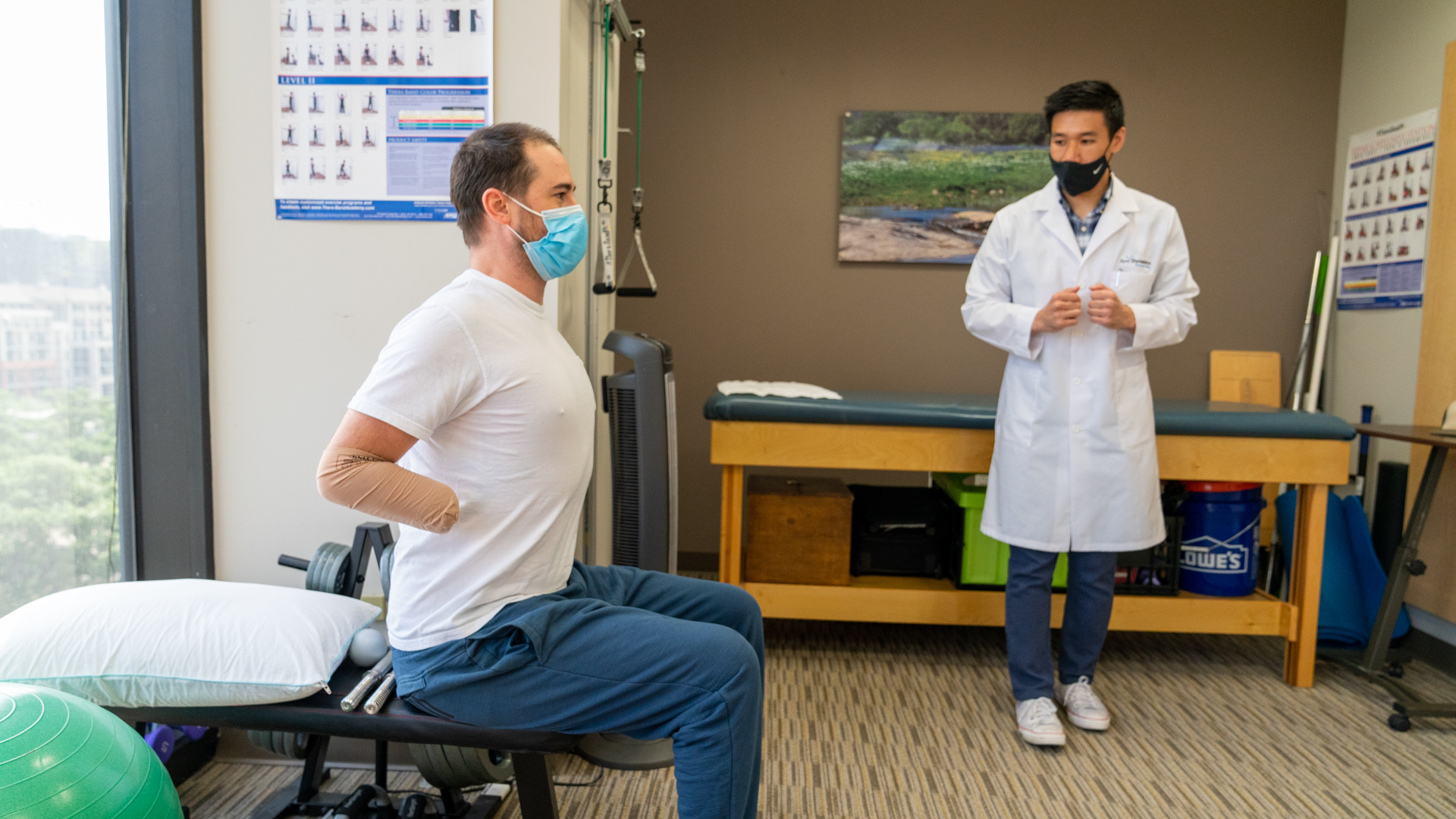 Arm Dynamics Clinical Therapy Specialist working with bilateral amputees on range of motion