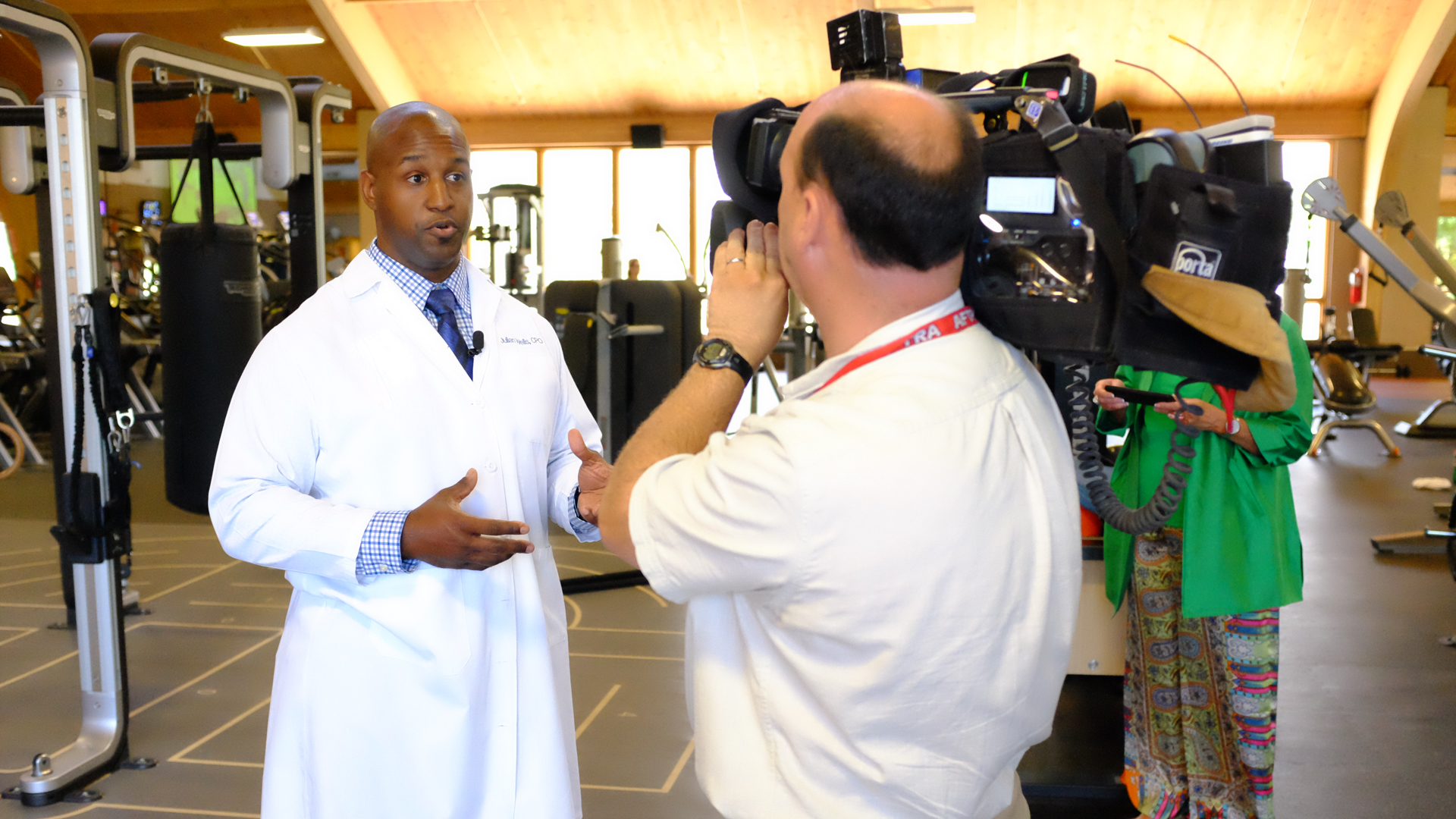 Julian Wells being interviewed by a news crew working on a story about patient Max Okun