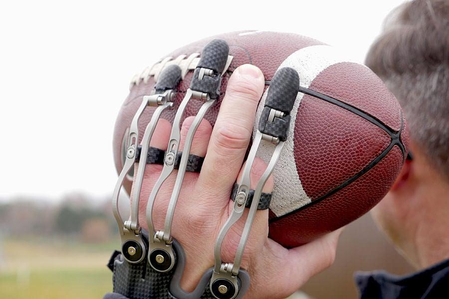 Naked Prosthetics MCP Drivers throwing Football