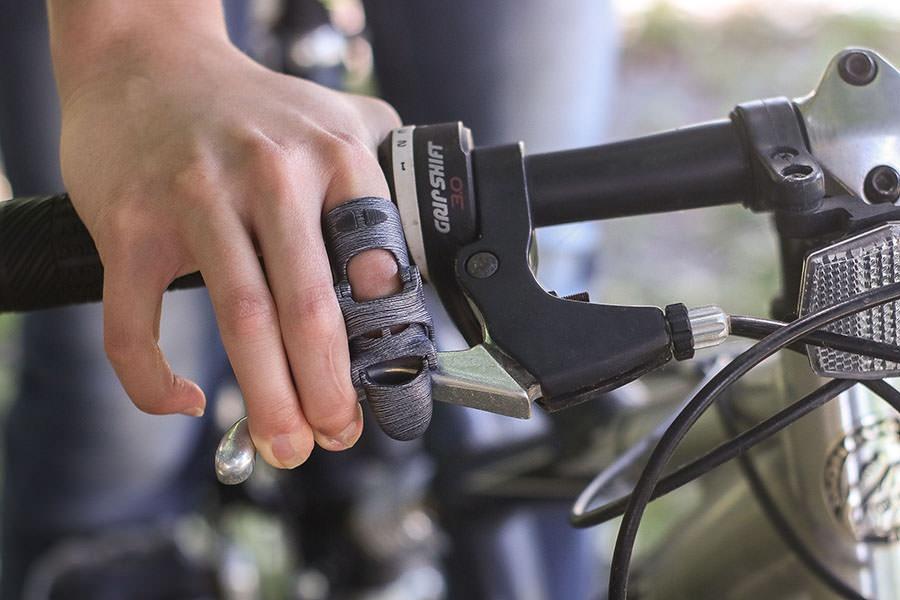 Naked Prosthetics PIP Driver Holding Bike Handlebar