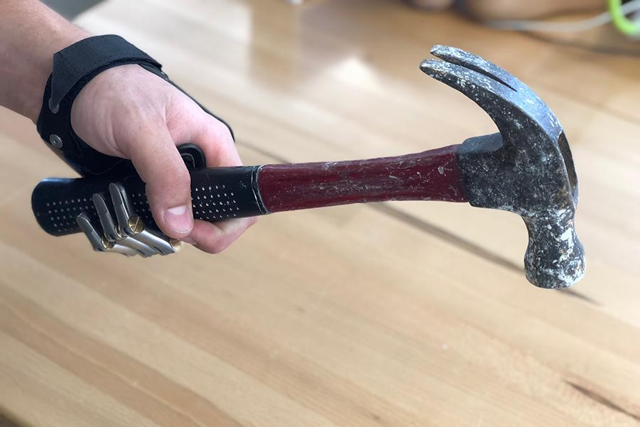 Point Design Digits holding a hammer