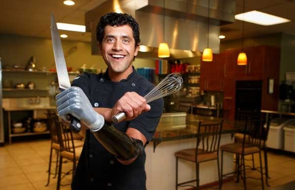 Eduardo Garcia in the kitchen with his i-limb hand