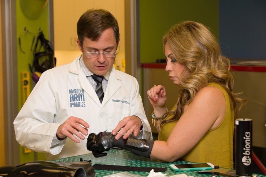 Prosthetist MacJulian Land checks alignment of the prosthesis