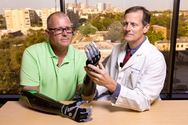 Arm Dynamics patient working with his myoelectric hand prostheses
