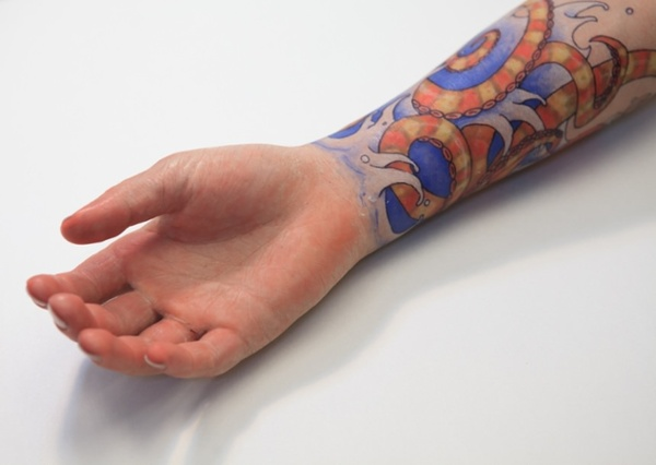 Custom silicone restoration prosthesis with tattoo decoration