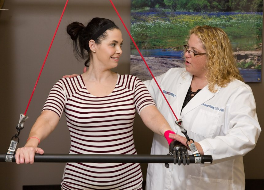 Arm Dynamics occupational therapist instruction patient how to properly use her multi-positional joints prosthesis