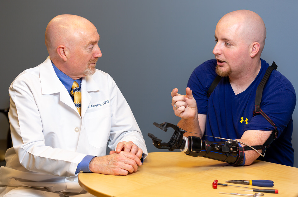 Prosthetist discussing options with patient